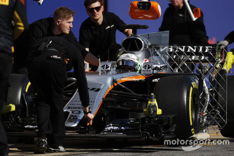 Alfonso Celis, Force India, is pushed back into his garage by mechanics