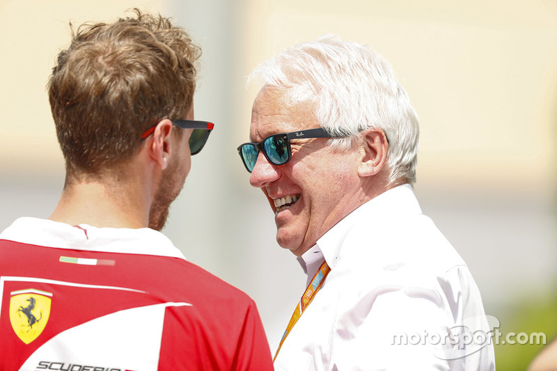 Sebastian Vettel, Ferrari, with Charlie Whiting, FIA Race Director