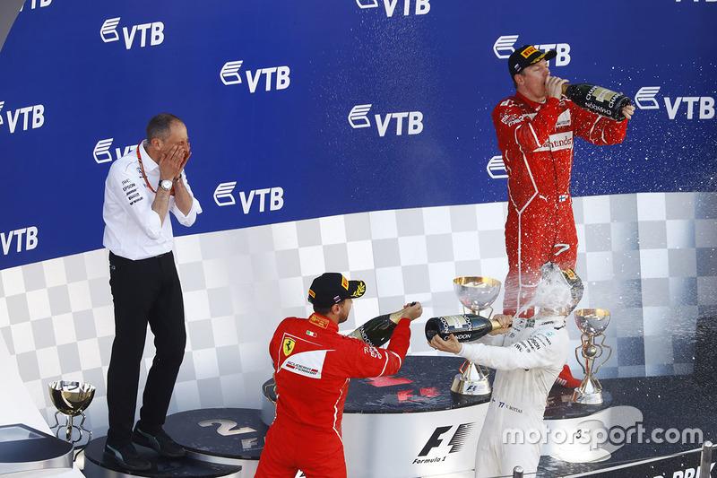 Second place Sebastian Vettel, Ferrari, Race winner Third place Valtteri Bottas, Mercedes AMG F1 Kimi Raikkonen, Ferrari, celebrate
