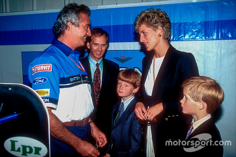 Flavio Briatore, Benetton, shows Lady Di, the Princess of Wales, and Prince Harry the team's garage