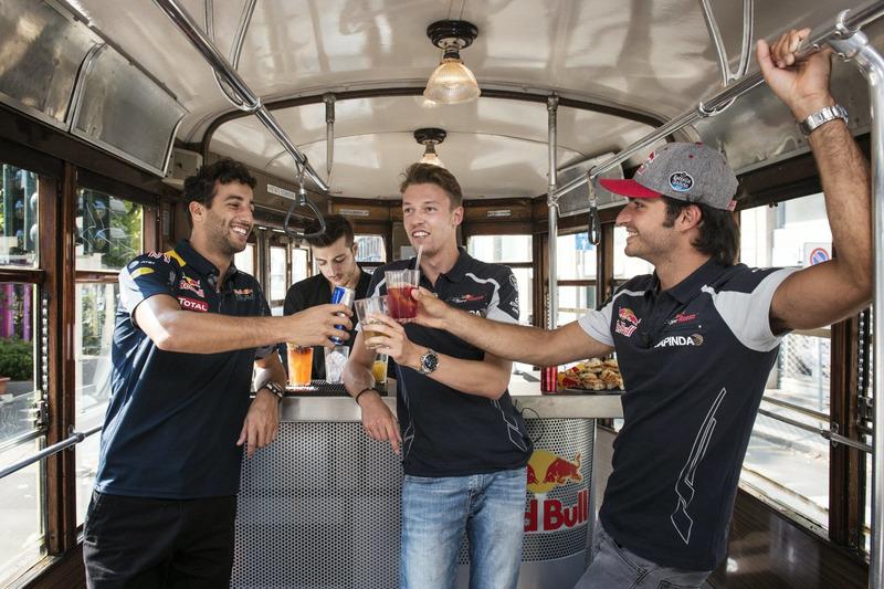 Daniel Ricciardo, Carlos Sainz Jr. and Daniil Kvjat enjoy their aperitivo on the historical tram of Milano