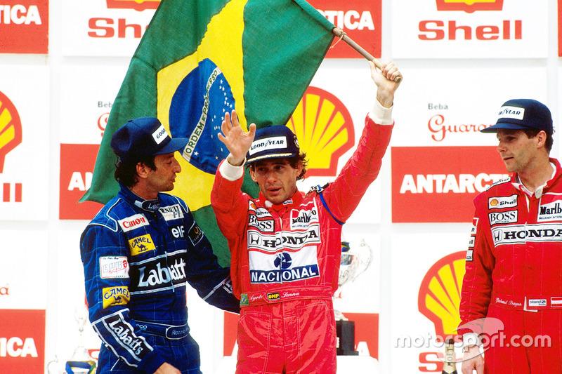 Podium: winnaar Ayrton Senna, McLaren, tweede plaats Riccardo Patrese, Williams, derde plaats Gerhar