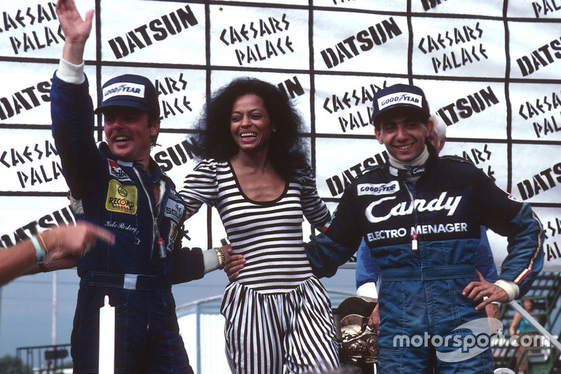 Podium: race winner Michele Alboreto, Tyrell Ford, second place and World Champion Keke Rosberg, Williams Ford
