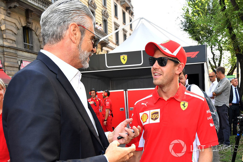 Maurizio Arrivabene, Ferrari Team Principal e Sebastian Vettel, Ferrari