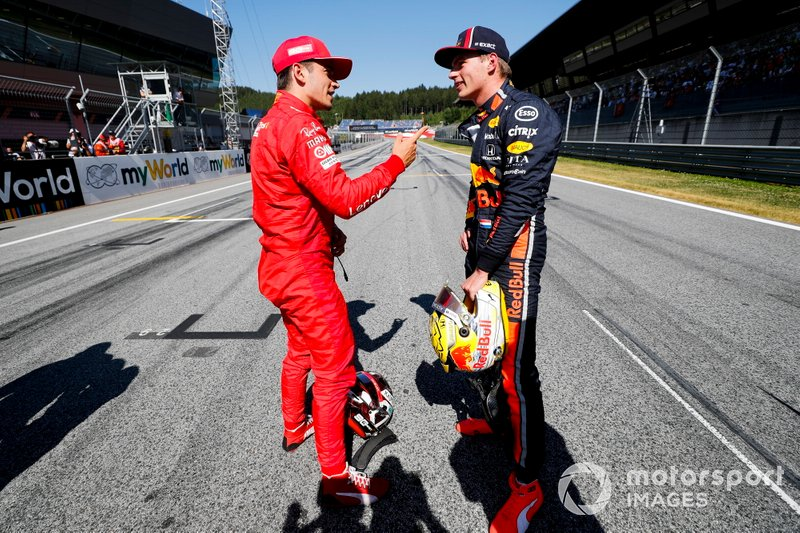 Pole sitter Charles Leclerc, Ferrari, talks with Max Verstappen, Red Bull Racing