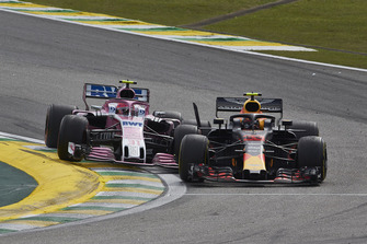 Max Verstappen, Red Bull Racing RB14, and Esteban Ocon, Racing Point Force India VJM11, make contact