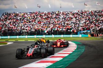 Kevin Magnussen, Haas F1 Team VF-18, leads Kimi Raikkonen, Ferrari SF71H, and Stoffel Vandoorne, McLaren MCL33