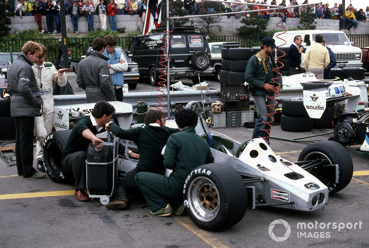 Derek Daly and mechanics work on his Williams FW08