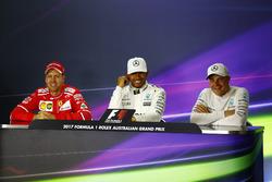 Sebastian Vettel, Ferrari, Lewis Hamilton, Mercedes AMG, and Valtteri Bottas, Mercedes AMG, in the post qualifying Press Conference