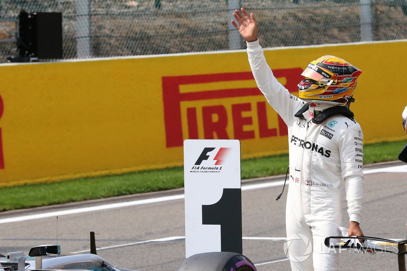 Lewis Hamilton, Mercedes AMG F1, celebrates a record equalling 68th Pole start