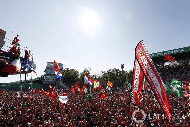 Third place Sebastian Vettel, Ferrari, celebrates, a partisan crowd