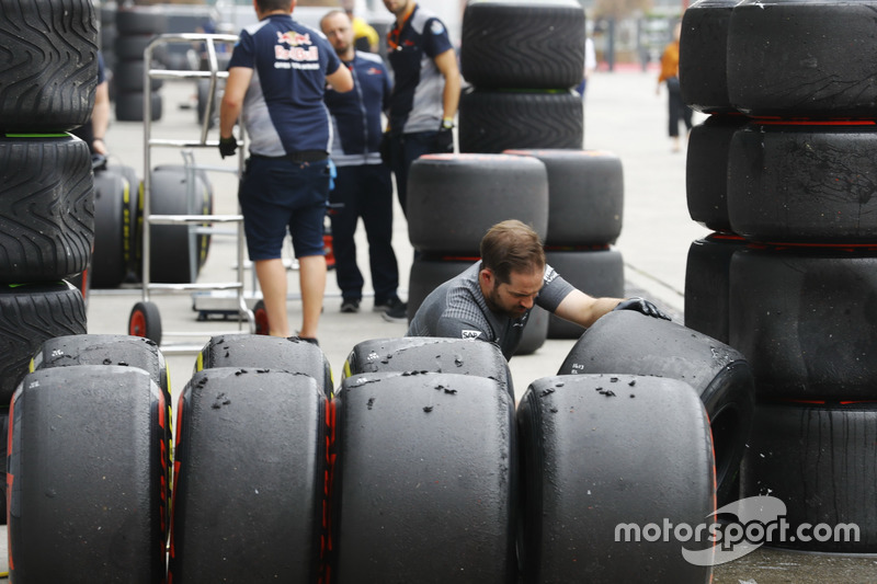 A McLaren engineer inspects sets of Soft and Super Soft tyres