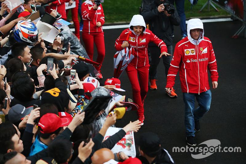 Kimi Raikkonen, Ferrari SF70H, attends an autograph session