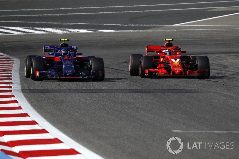 Pierre Gasly, Scuderia Toro Rosso STR13 and Kimi Raikkonen, Ferrari SF71H