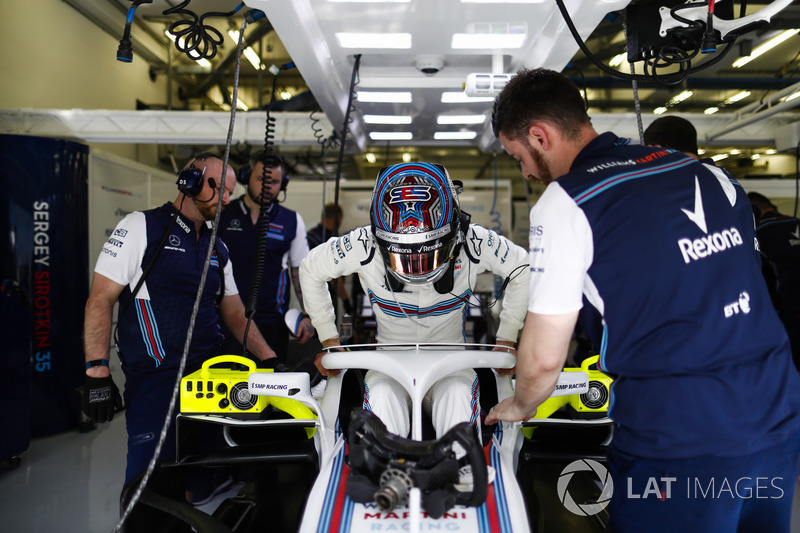 Sergey Sirotkin, Williams Racing, slides into his seat