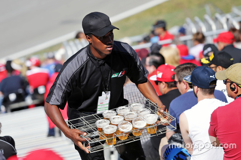 A drinks vendor in the grandstand