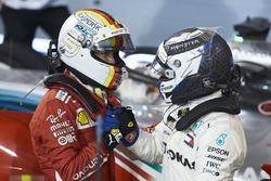 Valtteri Bottas, Mercedes AMG F1, 2nd position, congratulates Sebastian Vettel, Ferrari, 1st position, in Parc Ferme