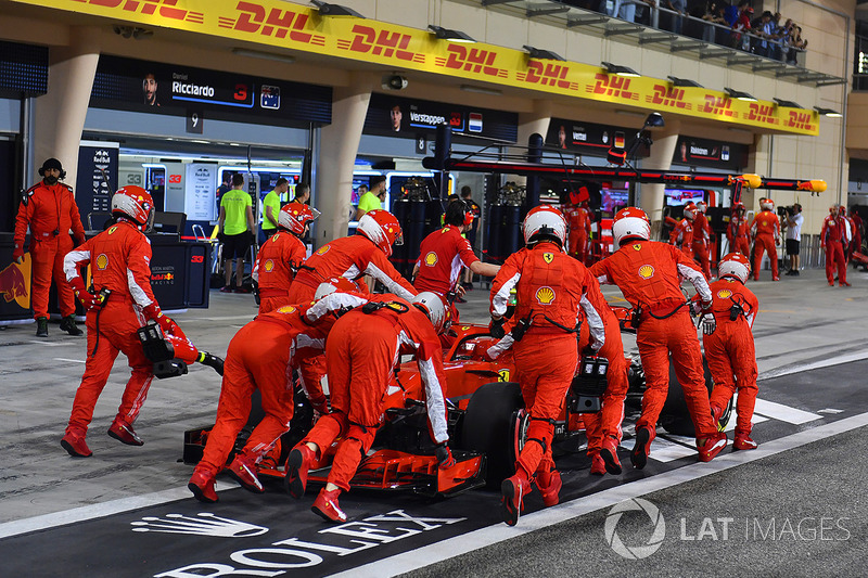 The car of Kimi Raikkonen, Ferrari SF71H is pushed back to the pit