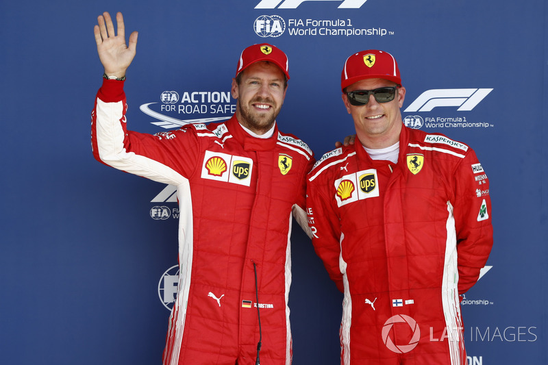 Sebastian Vettel, Ferrari, and Kimi Raikkonen, Ferrari, celebrate after qualifying