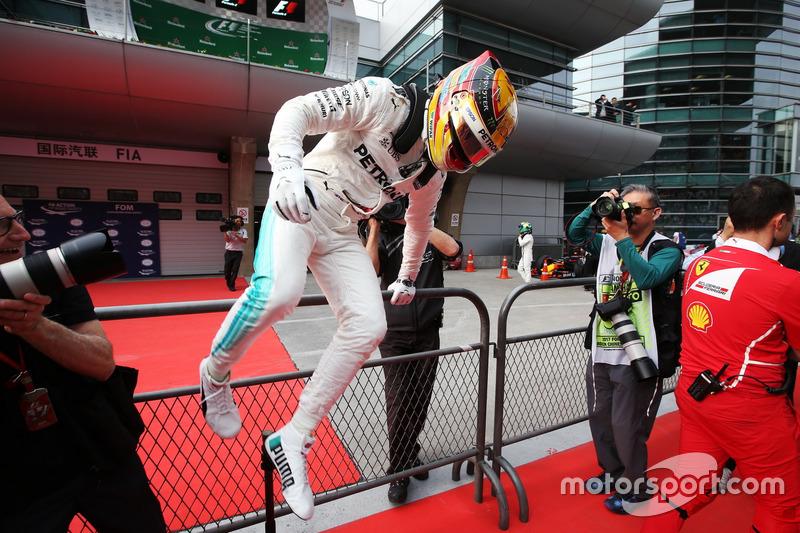 Lewis Hamilton, Mercedes AMG, celebrates pole in Parc Ferme