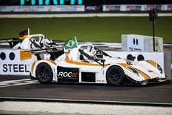 Helio Castroneves, beats Sebastian Vettel, driving the Radical SR3 RSX