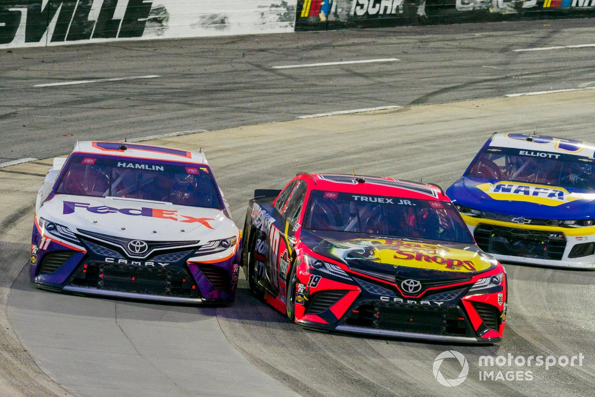 Martin Truex Jr., Joe Gibbs Racing, Toyota Camry Bass Pro and Denny Hamlin, Joe Gibbs Racing, Toyota Camry FedEx Office battle for the lead