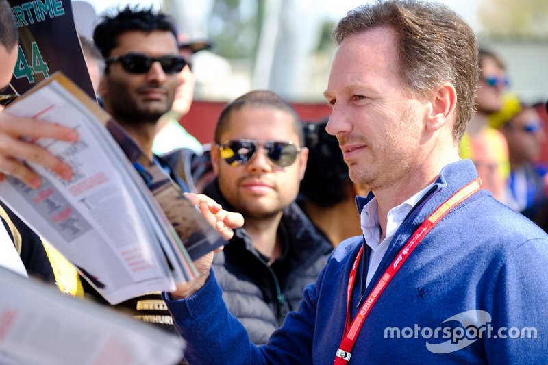 Christian Horner, Team Principal Red Bull Racing signs autographs for fans