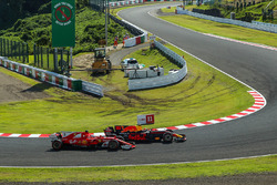 Sebastian Vettel, Ferrari SF70H and Max Verstappen, Red Bull Racing RB13 battle for position