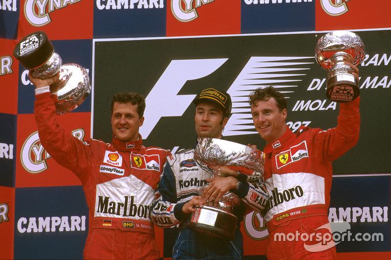 Podium: Race winner Heinz-Harald Frentzen, Williams FW19 Renault, second place Michael Schumacher, Ferrari, third place Eddie Irvine, Ferrari