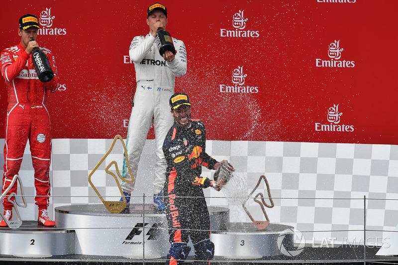 Подіум: переможець гонки гонки Валттері Боттас, Mercedes AMG F1, друге місце Себастьян Феттель, Ferrari, третє місце Даніель Ріккардо, Red Bull Racing