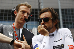 Fernando Alonso, McLaren, talks to his engineer