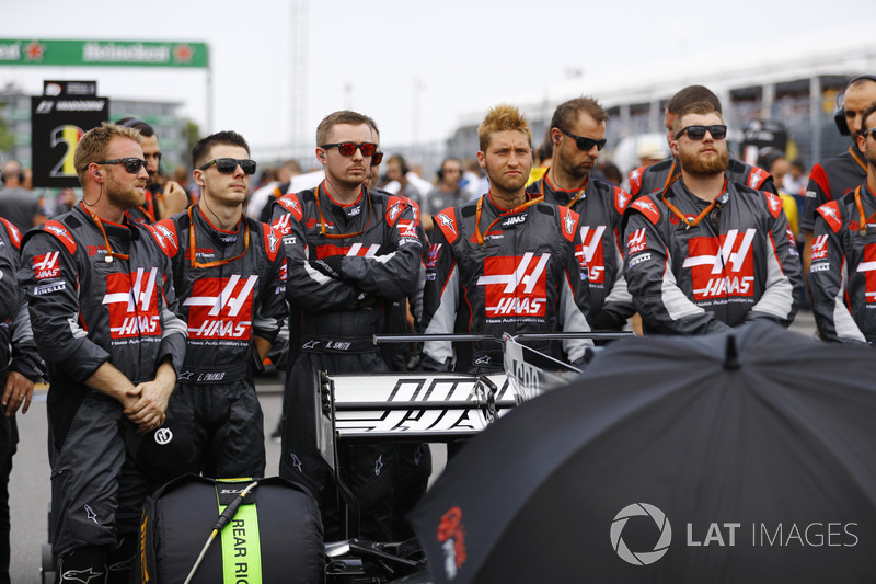 Haas F1 Team members observe a minute's silence