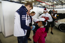 Sergey Sirotkin, Williams Racing, signs autographs for young fans