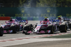Sergio Perez, Force India VJM11, battles with Esteban Ocon, Force India VJM11, ahead of Charles Leclerc, Sauber C37, at the start
