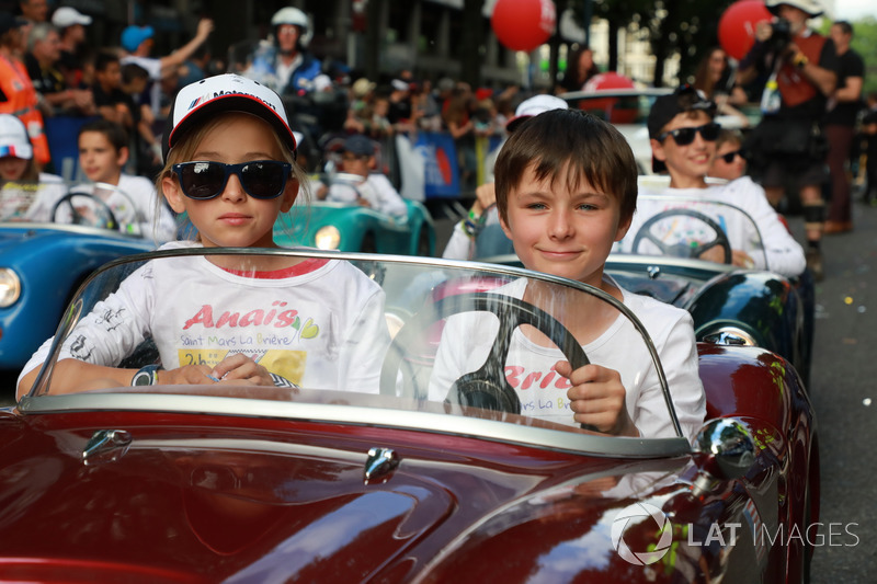 Little cars on the drivers parade
