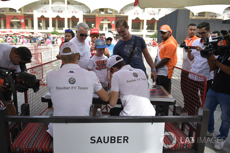 Charles Leclerc, Sauber and Marcus Ericsson, Sauber at the autograph session