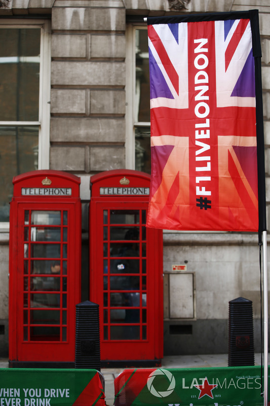 F1 Live London flags alongside traditional British Red Telephone Boxes