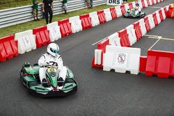 David Coulthard races football player Christian Karembeu in karts