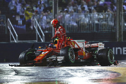 Kimi Raikkonen, Ferrari SF70H leaves his car after his collision, Max Verstappen, Red Bull Racing RB