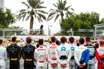 Drivers line up for the national anthem