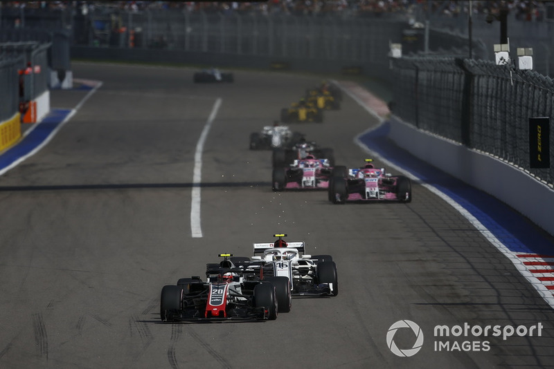 Kevin Magnussen, Haas F1 Team VF-18 and Charles Leclerc, Sauber C37