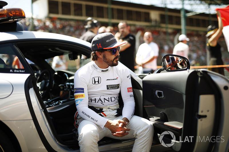 Fernando Alonso, McLaren, sits in an official car