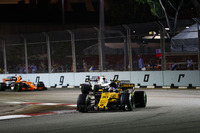 Jolyon Palmer, Renault Sport F1 Team RS17 leads Lance Stroll, Williams FW40 and Stoffel Vandoorne, McLaren MCL32
