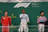 Kimi Raikkonen, Ferrari, Lewis Hamilton, Mercedes-AMG F1 and Sergio Perez, Force India on the podium