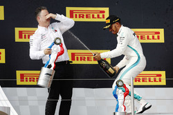 Ron Meadows, Sporting Director, Mercedes AMG, and Lewis Hamilton, Mercedes AMG F1, spray the champagne on the podium