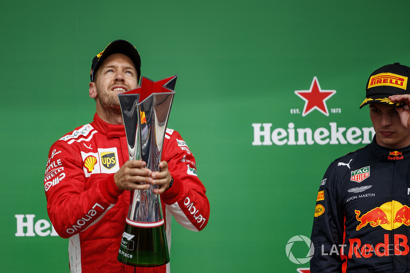 Sebastian Vettel, Ferrari, 1st position, with his trophy and Max Verstappen, Red Bull Racing, 3rd position, on the podium