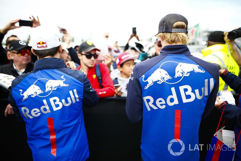 Pierre Gasly, Toro Rosso, and Brendon Hartley, Toro Rosso, sign autographs for fans