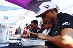 Mitch Evans, Jaguar Racing, signs an autograph