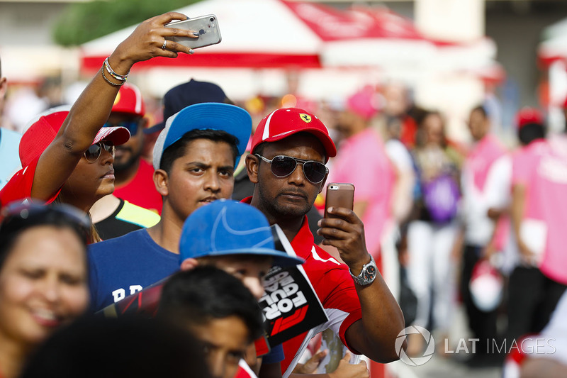 Fans take pictures of the Ferrari drivers