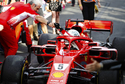 Sebastian Vettel, Ferrari SF71H, is greeted by Maurizio Arrivabene, Team Principal, Ferrari, after taking victory